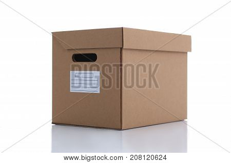 A carton box of kraft color isolated on white background. Theme of moving the loading of unloading cargo delivery of goods from the Internet to the purchaser from the supplier