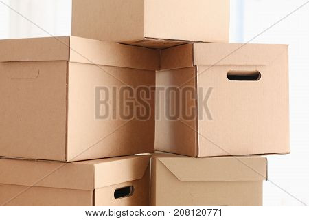 A lot of carton box of kraft color. Theme of moving the loading of unloading cargo delivery of goods from the Internet to the purchaser from the supplier