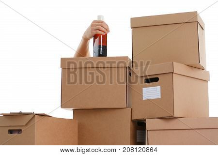 Hand specialist courier delivery service holding botle in hand background of boxes carried out delivery but could not due fact that he drank everything now in a drunken state can not work as a loader
