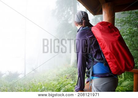 Photo from back of girl with backpack