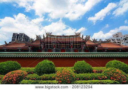 TAIPEI, TAIWAN - August 5, 2017 - Traditional Chinese architecture of Xingtian Temple contrasts with modern buildings in Taiwan's capital city