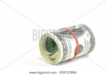 roll of hundred USA dollar bills with red rubber