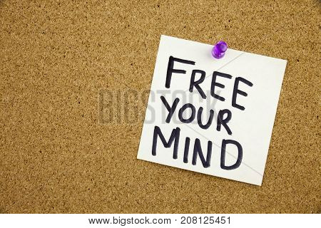 A Yellow Sticky Note Writing, Caption, Inscription Free Your Mind Message In Black Ext On A Sticky N