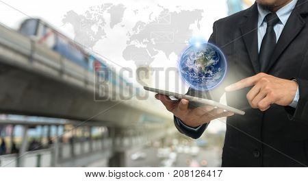Businessman using the smart phone with earth and world map on abstract Blurred photo of traffic jam with rush hour Elements of this image furnished, 3D illustration
