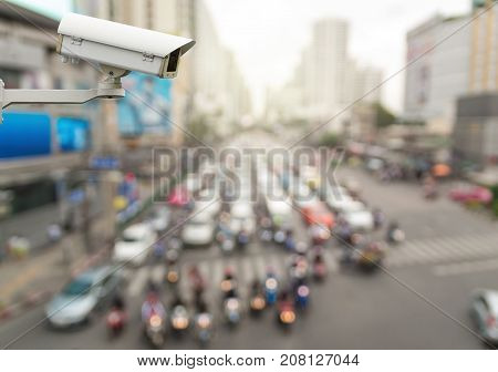 CCTV security camera on abstract Blurred photo of traffic jam with rush hour