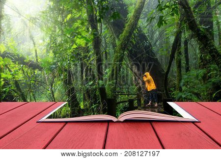 conceptual book image of Traveller taking photo at Beautiful rain forest