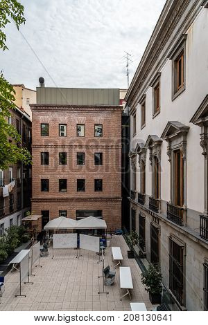Madrid, Spain - September 30, 2017: Exterior view of old palace and modern architecture extension. Courtyard of the IED Madrid. It is a Centre for Higher Education in Design