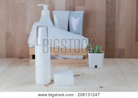 Skin Care Collection Contain Spray Bottle And Cotton Placed On Wood Floor. Have Wood Basket Include