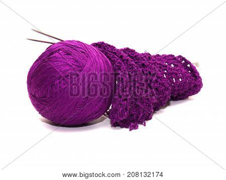 Purple clews and knitting over white background