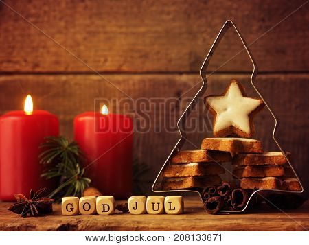 Star shaped cinnamon cookies in a tree shaped baking tin Christmas concept background Scandinavian Merry Christmas