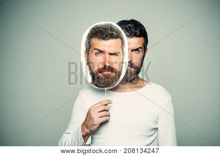 Man With Long Beard On Sad Face Hold Paper Nameplate