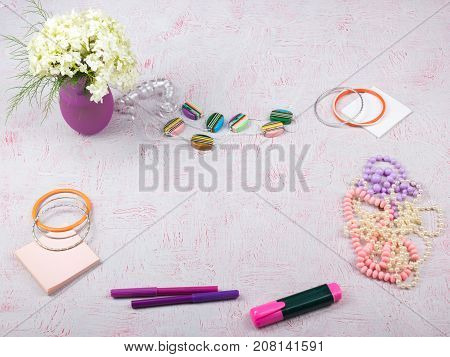 Workspace with computer, bouquet Hydrangeas, clipboard. Women's fashion accessories isolated on pink background. Flat lay. Top view office desk