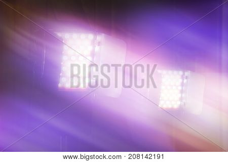 LED video and photography light on light stand in blurred background