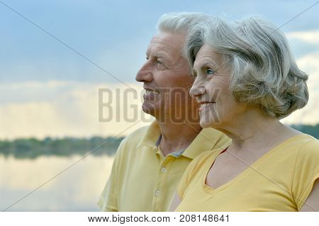 Beautiful happy elderly couple relaxing on beach
