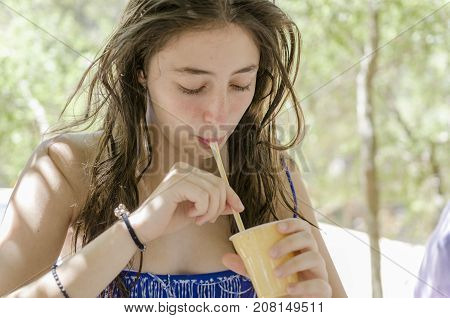 Beautiful Teenager Is Drinking A Cold Soft-drink.