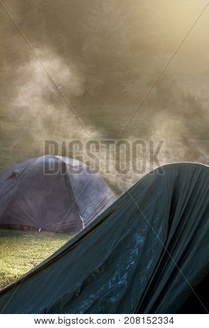 Tents in the morning light with steam coming out of them
