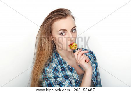 Beauty Portrait Of Young Adorable Fresh Looking Blonde Woman In Blue Plaid Shirt Posing With Candy L