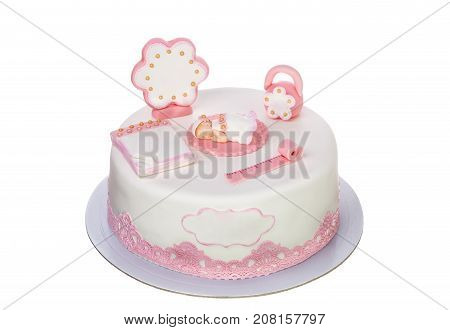 Decorative cake for a newborn girl for baptism. On a white background.