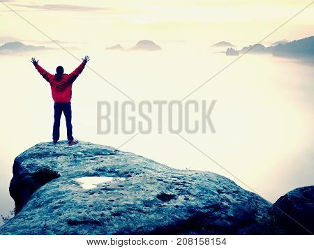 Mountain Summit. Happy Man Gesture Raised Arms. Funny Hiker With Raised Hands In The Air