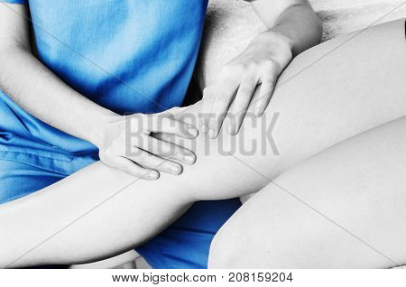 Physiotherapist, Chiropractor Doing A Patellar Mobilization, Knee Pain In Silhouette, Color And Blac