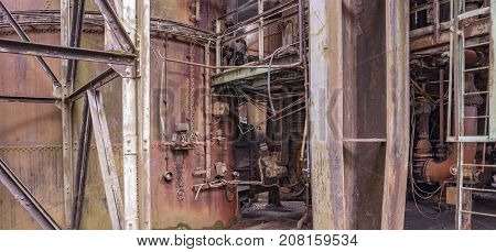 weathered rusty industrial scenery with old corroded appliances and girders