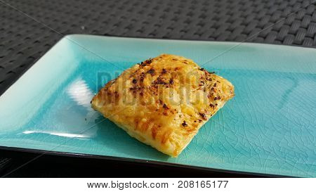 Puff pastry pizza snack with cheese crust