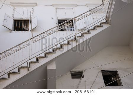 Traditional stair entrance of Lebanese white house with windows in Tyre, Lebanon