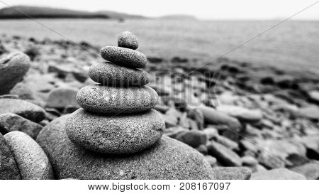 Harmony and balance, cairns, simple poise stones on white background, rock zen sculpture, five white pebbles, single tower, simplicity