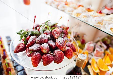 Close-up Photo Of Fresh Strawberries On The Wedding Banquet And Other Fruits On The Background.