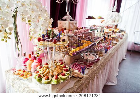 Variety Of Sweet Desserts With Fruits And Alcohol Drinks On The Wedding Banquet.