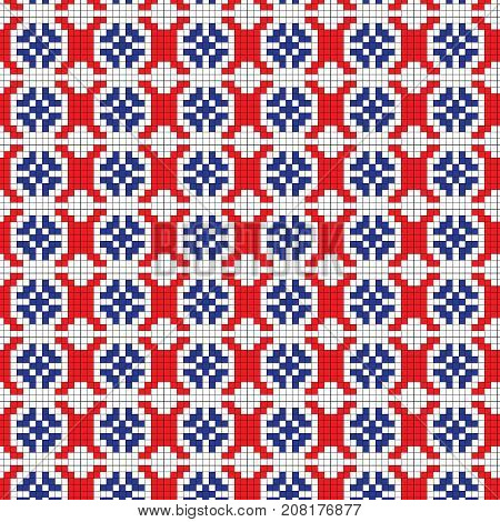 Isolated seamless texture with red, black and blue floral patterns on the fabric. Cross-stitch. Luhansk oblast.