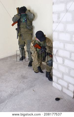 mercenary with AK-47 rifle inside the building poster