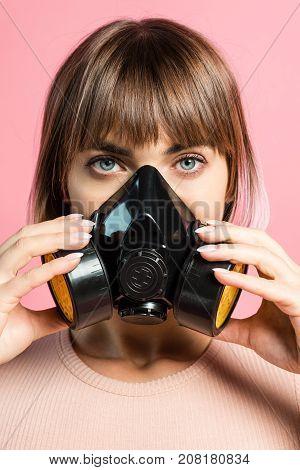 Young Woman Wearing Respirator