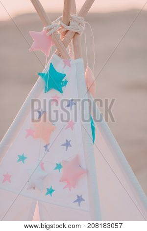pink vintage wigwam with colorful star s