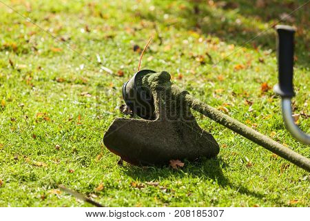 Mower Brushcutter On Green Grass