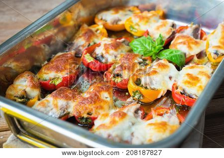 Stuffed peppers with sardines and mozzarella .