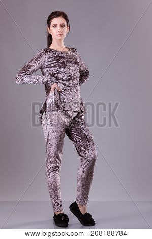 Brunette woman wear silk velvet suit clothes for businesswoman. office style over gray background. casual girl. fashion catalog. Studio shoot