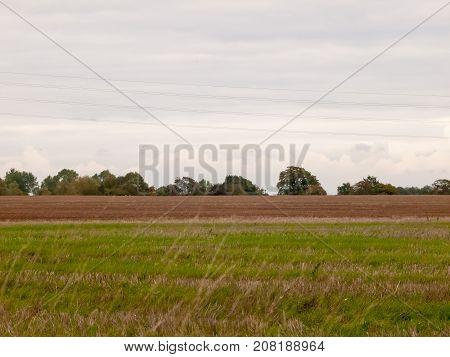 Farming Industry Field Brown White Sky Green Field In Front