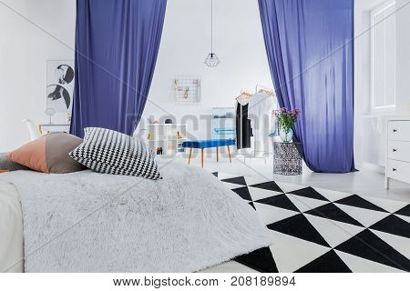 Sophisticated Bedroom With Geometric Carpet