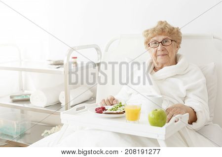 Elderly Eating Apple At Hospital