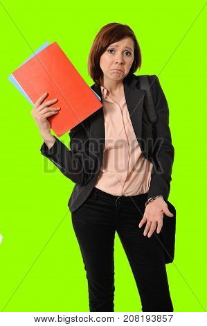 business red hair woman or student in stress thinking worried while carrying a portfolio notepads and wearing suit on green screen chroma croma key or cromakey background for composite