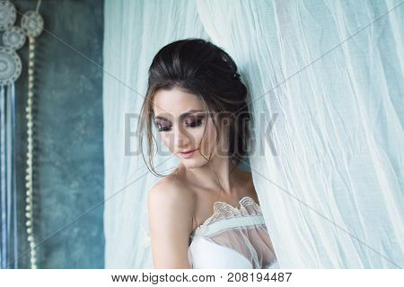 Beautiful Lady with Wedding Hairstyle and Makeup on White. Fashion Woman