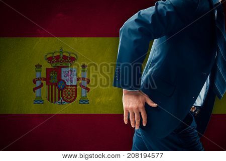 Catalonia separatism concept. Businessman (financier, bank employee, CEO, manager) run away (escape) from Spain represented by flag.