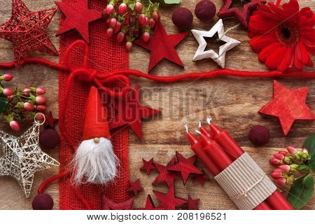 Red christmas decoration on a rustic wooden table for nicholas