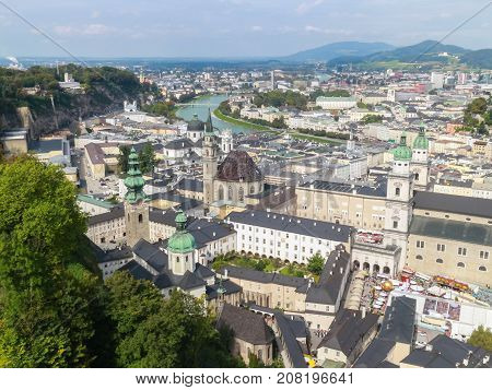 Bird eye view from the walls of the fortress of the Salzach river and the old city in center of Salzburg Austria