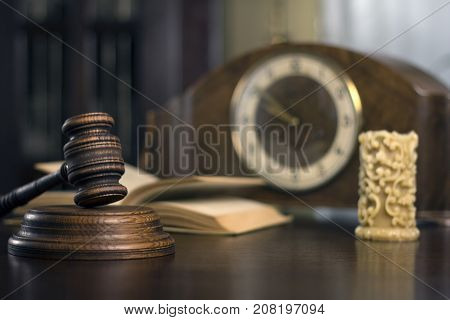 justice and law concept. Male judge in a courtroom with the gavel,