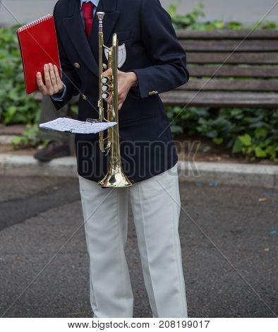 Band orchestral musician with trumpet in hand