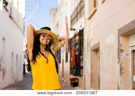 Happy smiling shine woman in hat and glasses,vacations traveler in europe,greece,santorini,turkey,eurotrip