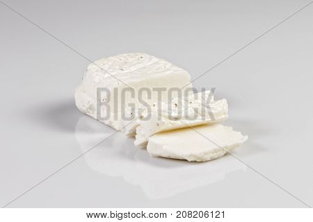 Sliced halloumi cheese with mint isolated on white