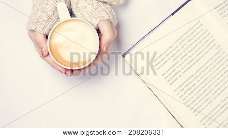 Girl Holding Cup Of Coffee With Latte Art. Leisure Time Concept. Pastel Colors